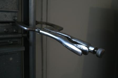 We recommend that once the door is closed that you clamp the door down using a vise grip or clamp above one of the rollers to prevent the door from being opened from the outside