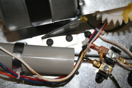Remove the four 5/16� hex head screw�s that hold the motor assembly to the frame of the garage door opener. Be sure to put your hand under the motor before removing the last screw to prevent the motor from falling.